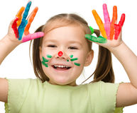 Cute cheerful girl with painted hands Stock Images