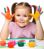 Cute cheerful girl with painted hands Royalty Free Stock Images