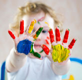 Cute cheerful girl with painted hands Stock Photos