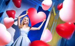 Cute cheerful lady among balloons Royalty Free Stock Image