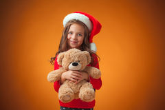 The cute cheerful little girl on orange background Royalty Free Stock Image