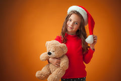 The cute cheerful little girl on orange background Stock Photography