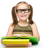 Cute cheerful little girl reading book Royalty Free Stock Photo
