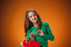 The cute cheerful little girl with shopping bags Royalty Free Stock Photos