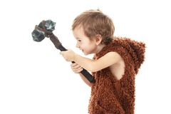 Cute cheerful naughty child playing with axe isolated on white. Cute cheerful naughty child playing with axe. Humorous concept ancient caveman isolated on white Royalty Free Stock Photo