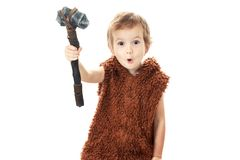 Cute cheerful naughty child playing with axe isolated on white. Cute cheerful naughty child playing with axe. Humorous concept ancient caveman isolated on white stock photos