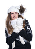 Cute cheerful teenage girl posing in the studio. Showing emotions. Wearing knitted woolen sweater, scarf, hat and mittens. Stock Photo