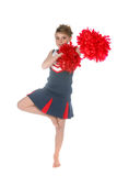 Cute cheerleader balancing on one leg Stock Image