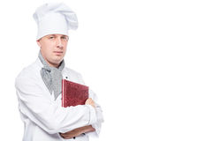 Cute chef with a menu in his hands posing Royalty Free Stock Photography