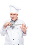 Cute chef with a sharp knife posing in the studio on a white. Background Stock Images