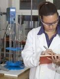 Cute chemist working in laboratory Stock Photo