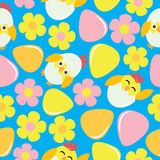 Cute chick, flower, and eggs on blue background  cartoon, Easter seamless pattern, wallpaper, and greeting card Royalty Free Stock Image