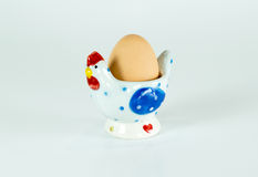 Cute chicken ceramic egg holder isolated Royalty Free Stock Images