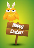 Cute chicken whit a bunny ears costume standing on a wooden sign Stock Images