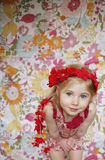Cute child. Cute blonde and blue eyed child wearing flower headband looking into camera Royalty Free Stock Photos