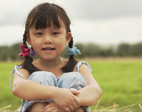 CUTE CHILD. Smiling girl in a farm Royalty Free Stock Photo