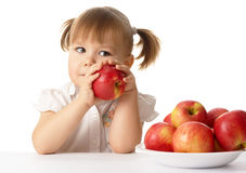 Cute child with apples Stock Photos