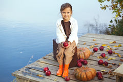 Cute child in autumn Royalty Free Stock Photo