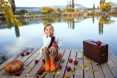 Cute child in autumn Stock Photos