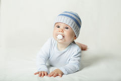 Cute child - baby with pacifier Royalty Free Stock Photography