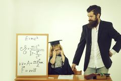 Cute child and bearded teacher stock images