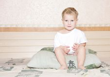Cute child on bed Stock Photos