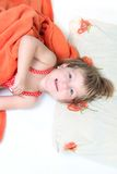 Cute child in bed over white Royalty Free Stock Photography