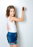 Cute child behind a white board Stock Photo