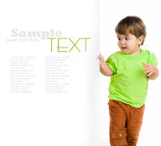 Cute child behind a white board Royalty Free Stock Images