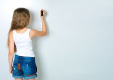 Cute child behind a white board Stock Photography