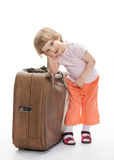 Cute child with a big trunk Stock Images