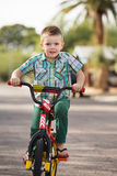 Cute Child On Bike Royalty Free Stock Images