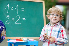 Cute child at blackboard practicing mathematics Royalty Free Stock Photography