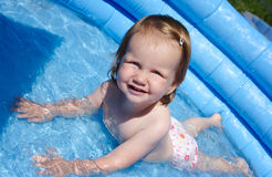 Cute child in blue swimming pool Stock Photos