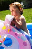 Cute child in blue swimming pool Royalty Free Stock Photo