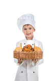 Cute Child Boy Bakery With Basket of Sesame and Raisin Buns, isolated on white. Background Stock Image