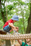 Cute child, boy, climbing in a rope playground structure Royalty Free Stock Photography