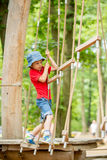 Cute child, boy, climbing in a rope playground structure Stock Photography