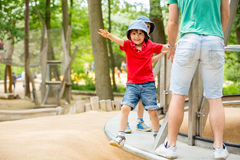 Cute child, boy, climbing in a rope playground structure Stock Photo
