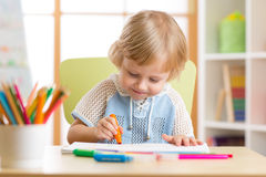 Cute child boy is drawing with felt-tip pen in preschool. Cute little child is drawing with felt-tip pen in preschool royalty free stock photos