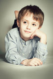 Cute child boy dreaming Stock Photography