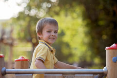 Cute child, boy, having fun on the playground, active kid climbi Royalty Free Stock Images