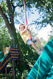 Cute child, boy, rides on Flying Fox play equipment in a childre Stock Photos