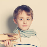 Cute child boy with toys Royalty Free Stock Images
