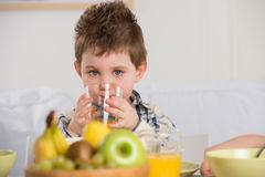 Cute child on breakfast Royalty Free Stock Images