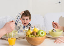 Cute child on breakfast Royalty Free Stock Photos