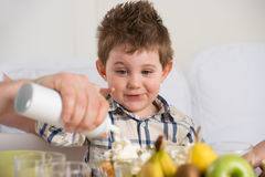 Cute child on breakfast Stock Image