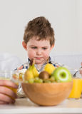 Cute child on breakfast Royalty Free Stock Image