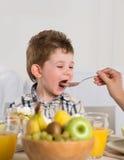 Cute child on breakfast Royalty Free Stock Photo