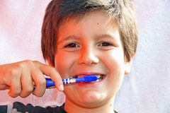 Cute child brushing teeth with toothbrush Stock Photos